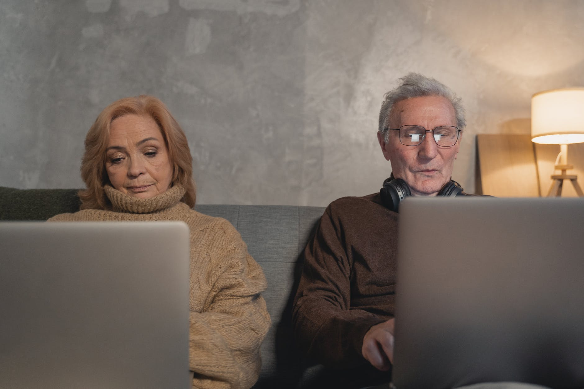two older people on couch, white